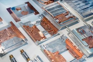 Aluminum-copper heat sink plates for industrial electronics. Equipment for cooling electronic components.