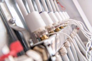 Home Underfloor Heat Valves Container Closeup. Heating Technologies.
