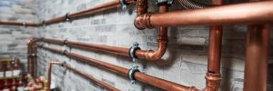 copper pipes of a private house autonomous heating system in boiler room. Plumbing services