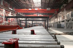 Cold rolling department in ferrous metallurgy factory with hardware under roof and forming rolls.