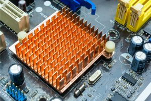 Close up view of copper heat sink or radiator on computer motherboard. Close up and side angle view.
